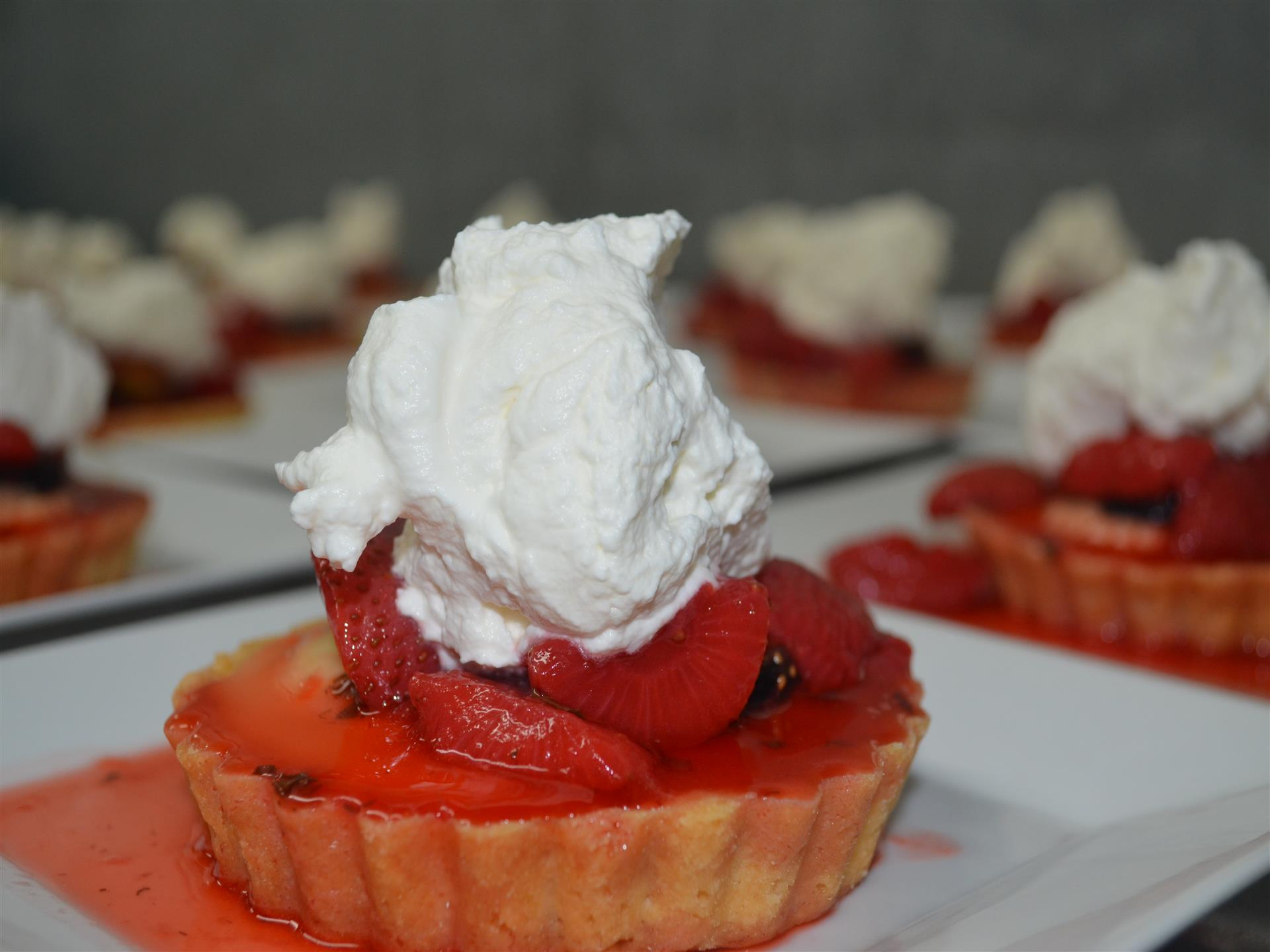 Strawberry tart topped with whipped cream