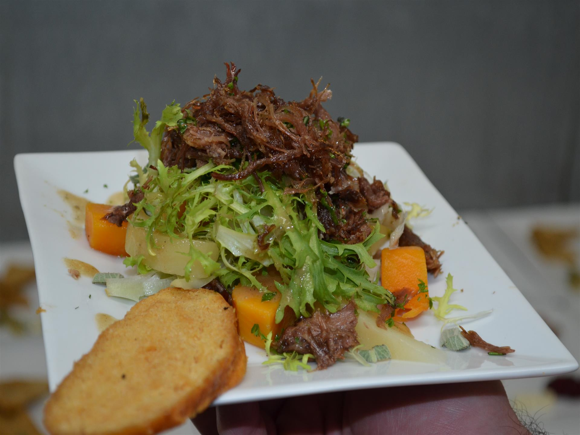 Shredded beef served over greens