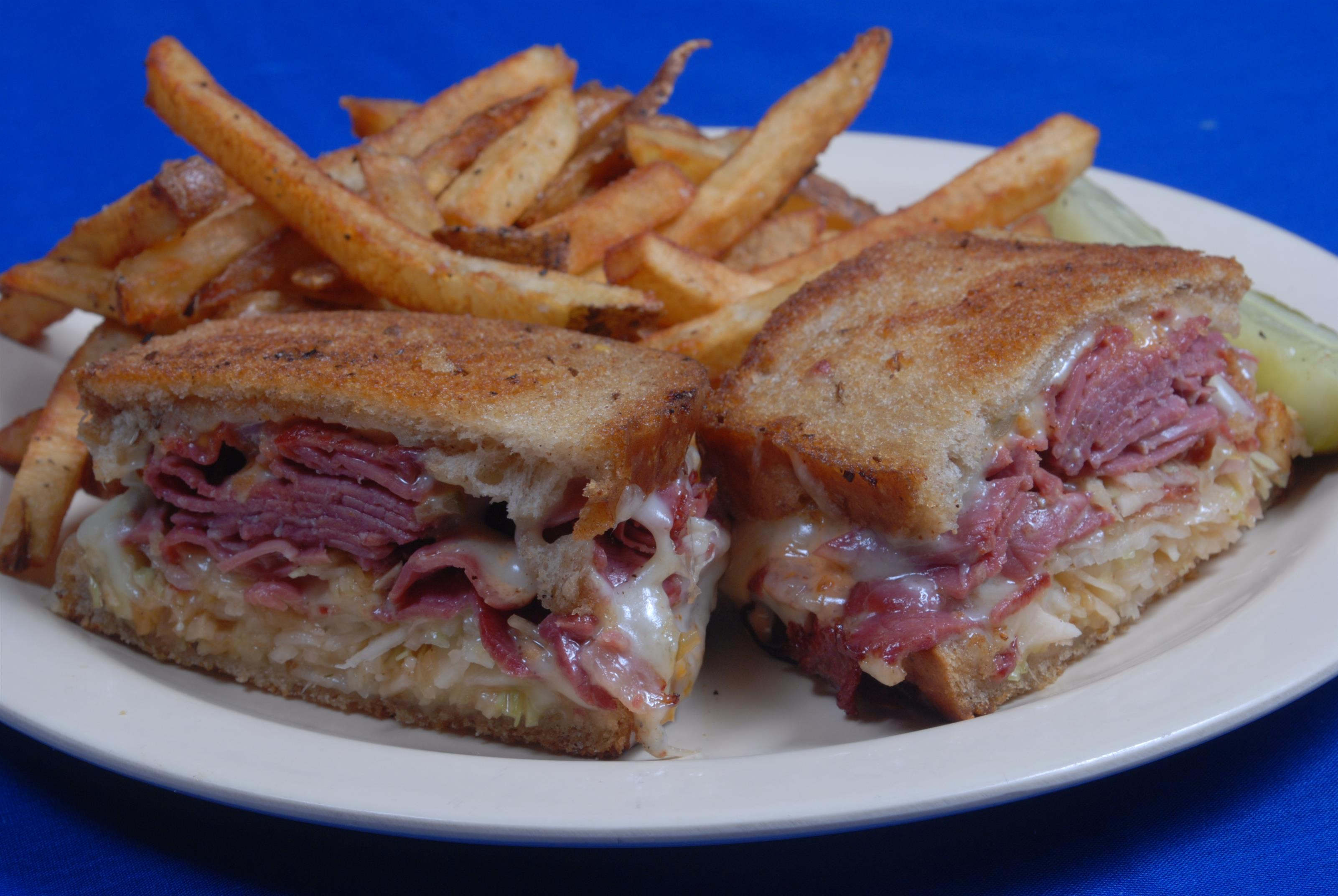 Rueben sandwich served with French fries