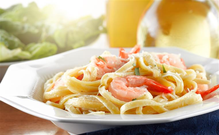 Linguini with shrimp in white dish