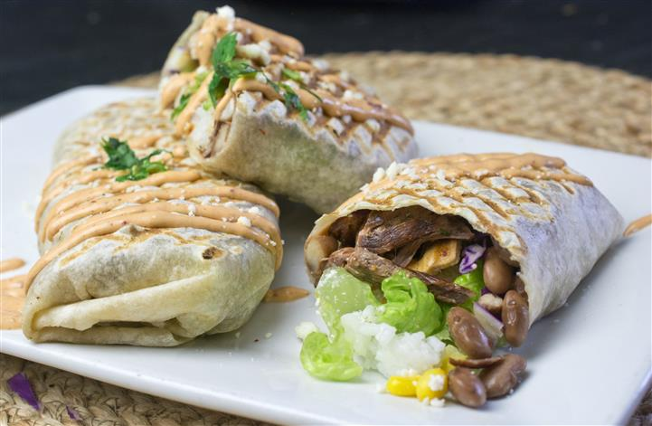 Three burritos with meat and black beans