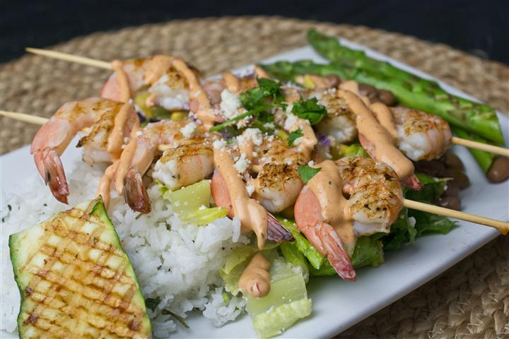Shrimp over rice, served with lettuce, asparagus, cheese & dressing