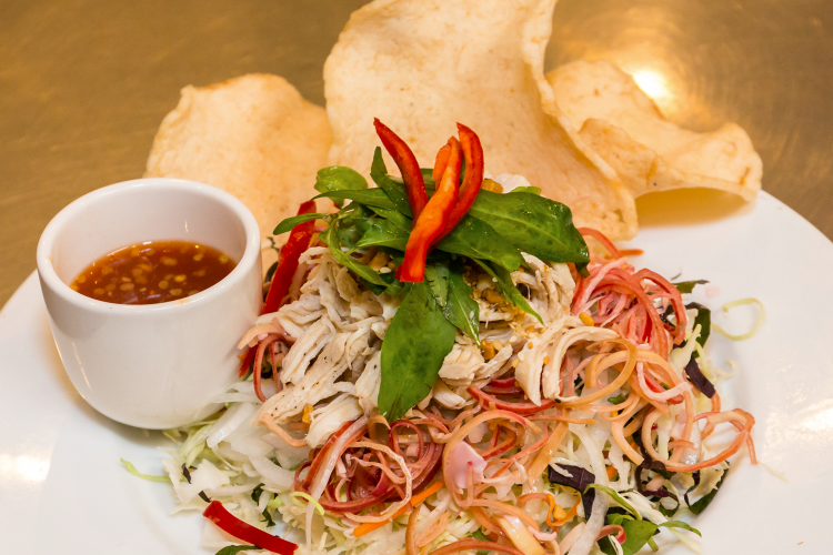 vietnamese noodle entree with chips and dipping sauce