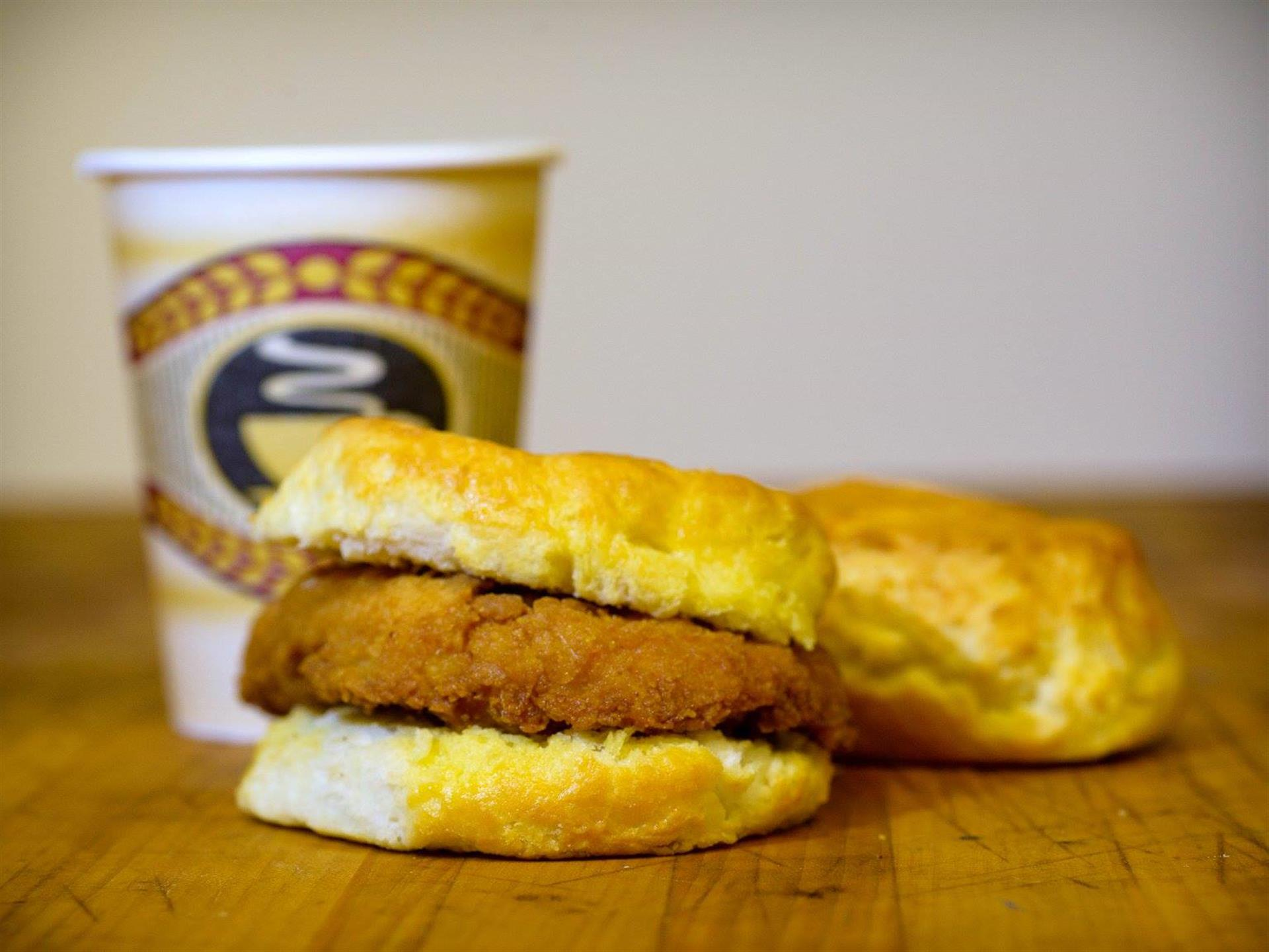 chicken biscuit with a cup of coffee