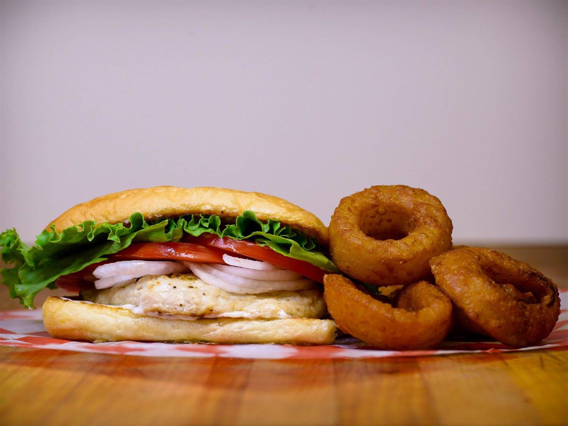 grouper sandwich with a side of onion rings