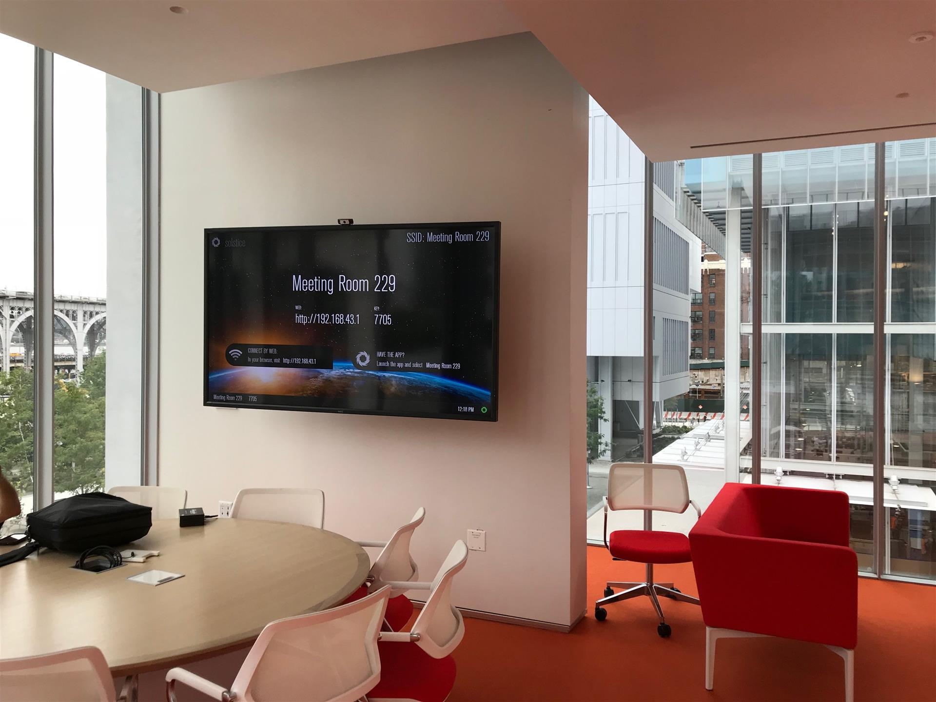 break room with a television on the wall and tables and chairs