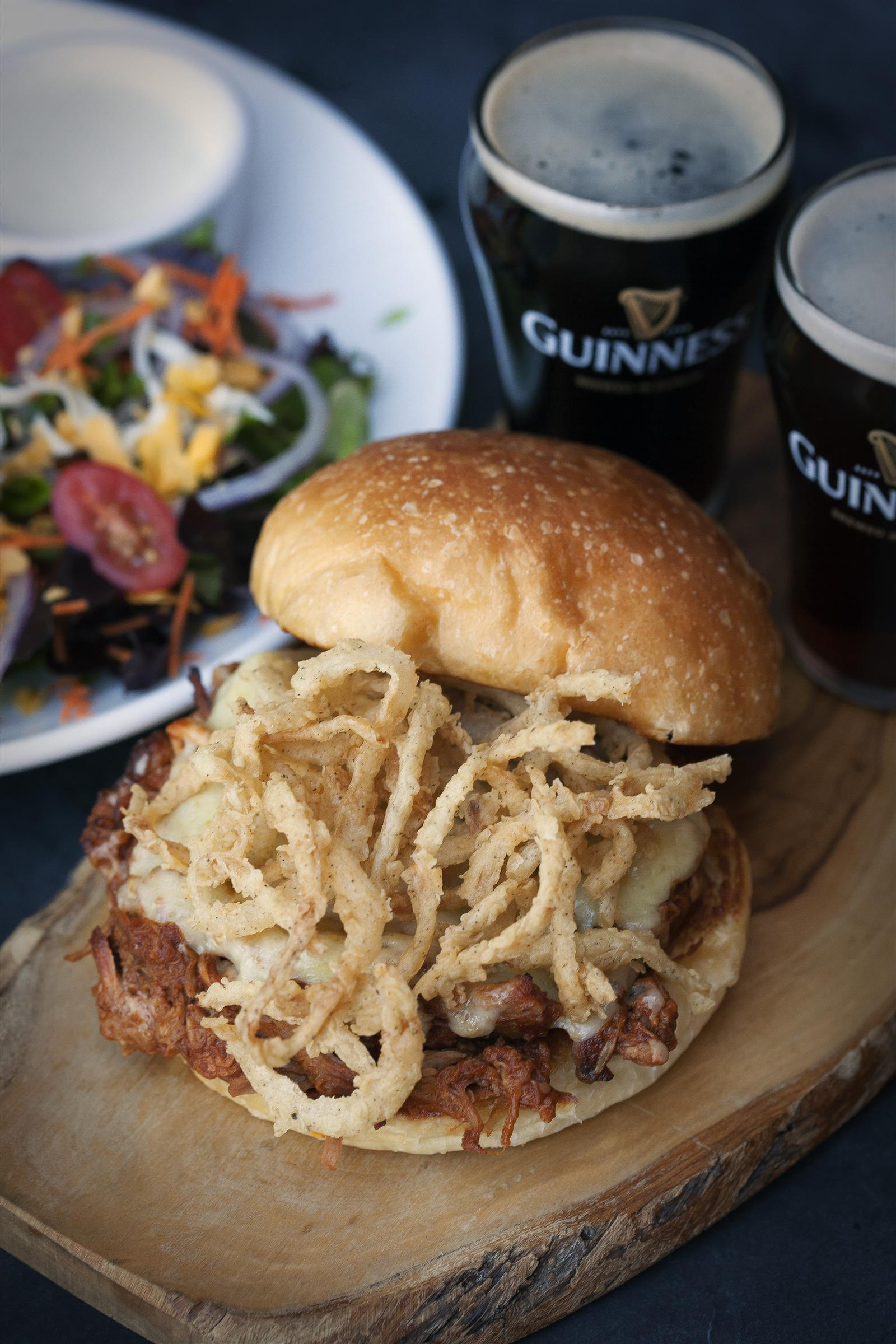 Twisted irishman. Pulled pork  topped with our signature Jameson BBQ sauce, Smithwick's ale battered onion straws and Irish cheddar