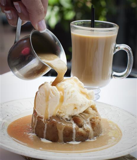 Julie Jet's Famous Bread Pudding. Made in-house, topped with vanilla ice cream & caramel.
