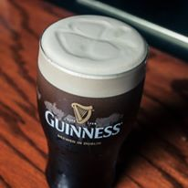 full guinness beer glass on counter