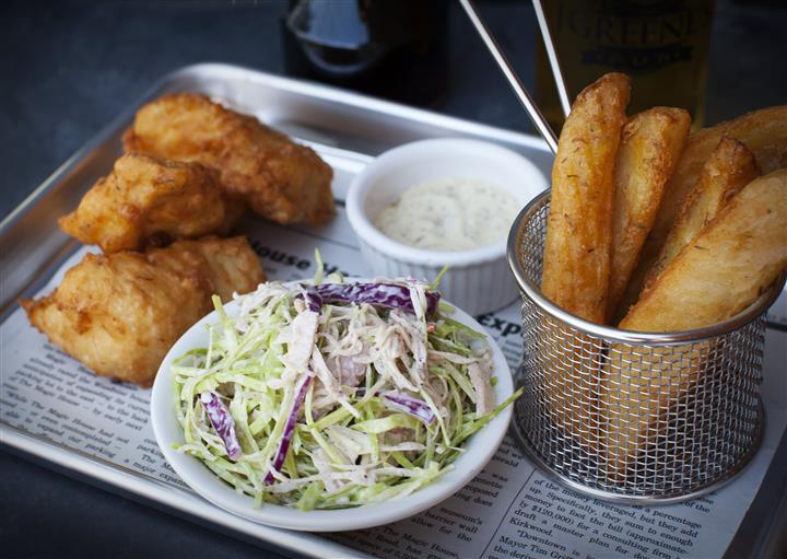 Fish and chips. Hand battered cod filets with curry pub chips, cole slaw & tartar sauce