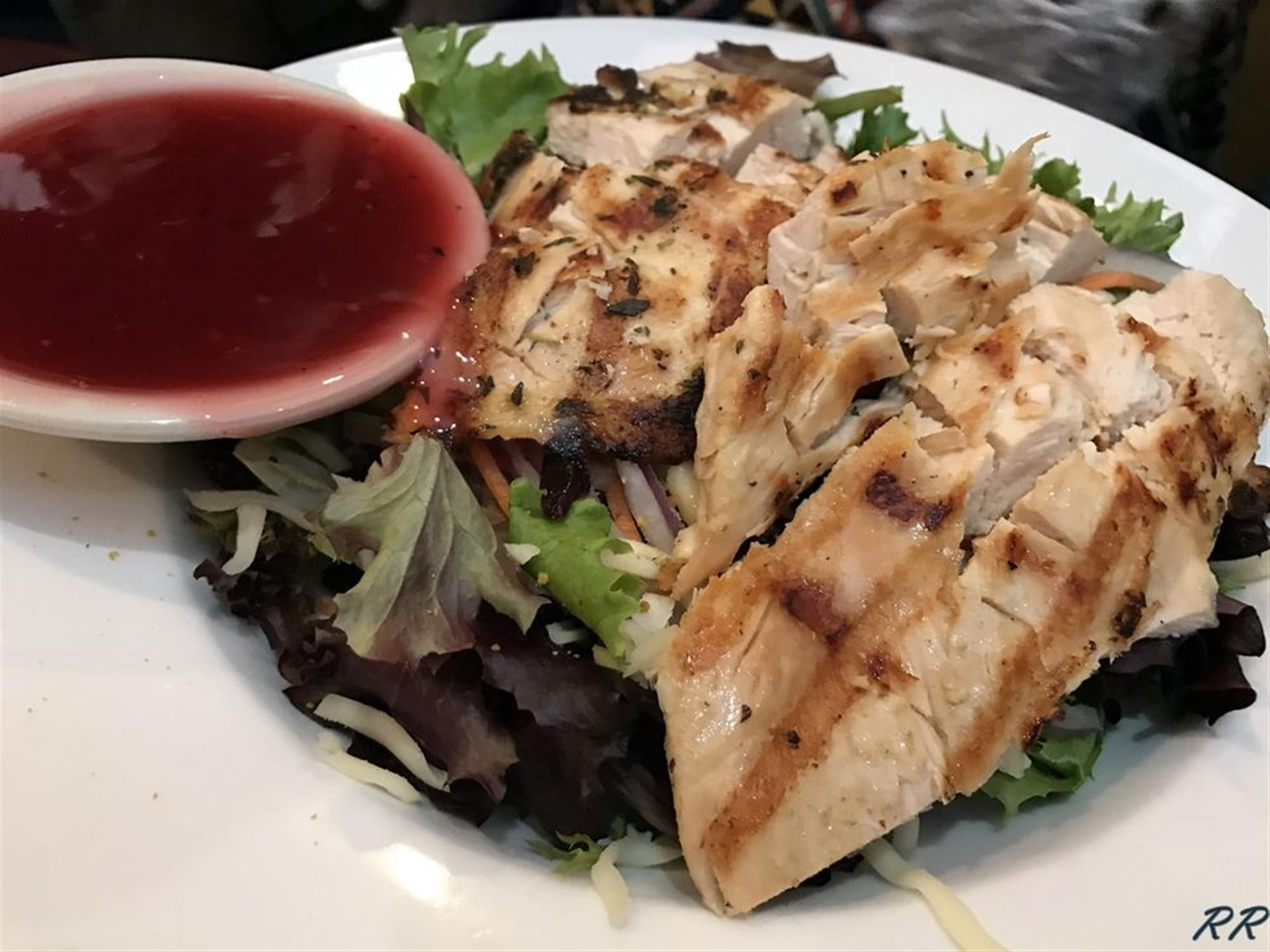 Grilled chicken over lettuce