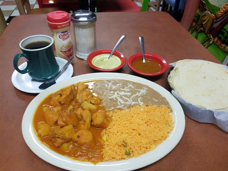 Dish of chicken, rice, refried beans with dipping sauces and cup of coffee