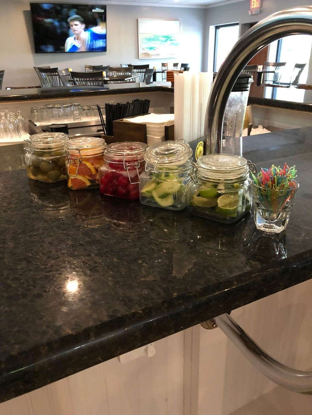 countertop with jars of vegetables