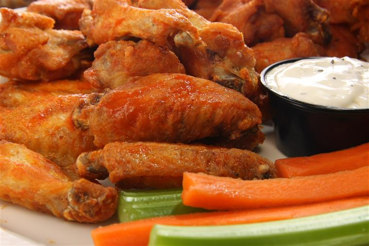 Buffalo wings with ranch dressing, celery, carrots