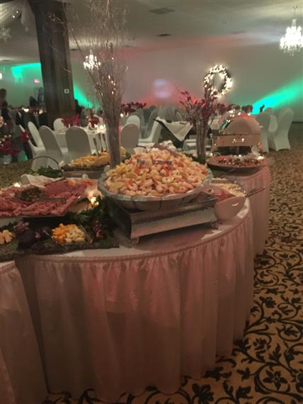 fancy table with several buffet trays