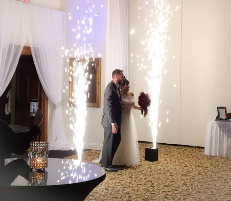 Married Couple entering recpetion with sparklers going off on each side of them