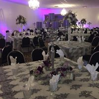 Wedding tables set up with glass wear and dish wear