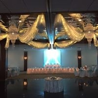 Wedding and wedding party table in front on dancefloor with blue lighting
