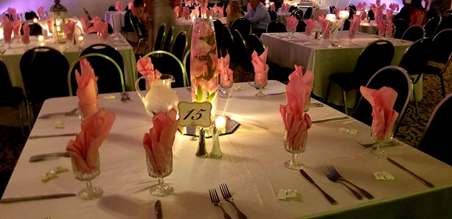 Table set up with table number, flowers, and candles