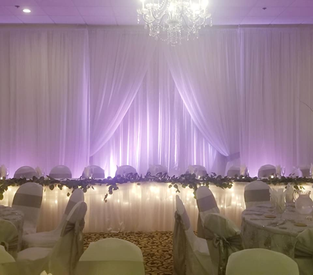 Venue lit up in lights and white drapes