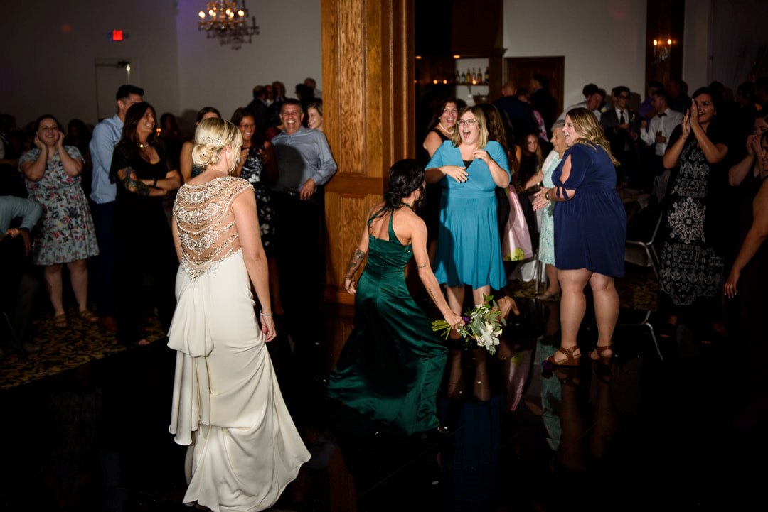 A girl catching the bouquet.