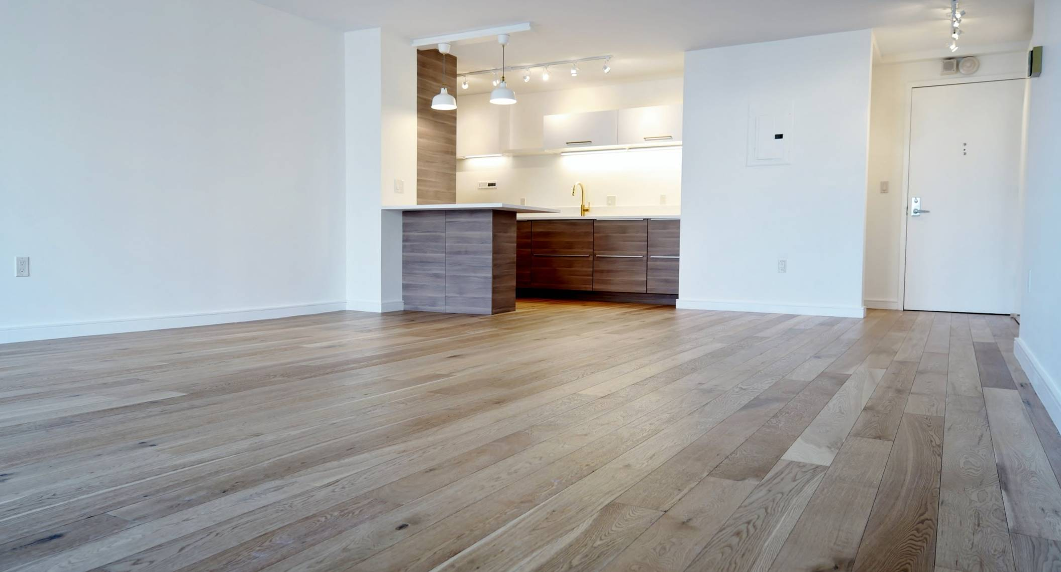 interior design showcasing wooden flooring and cabinets