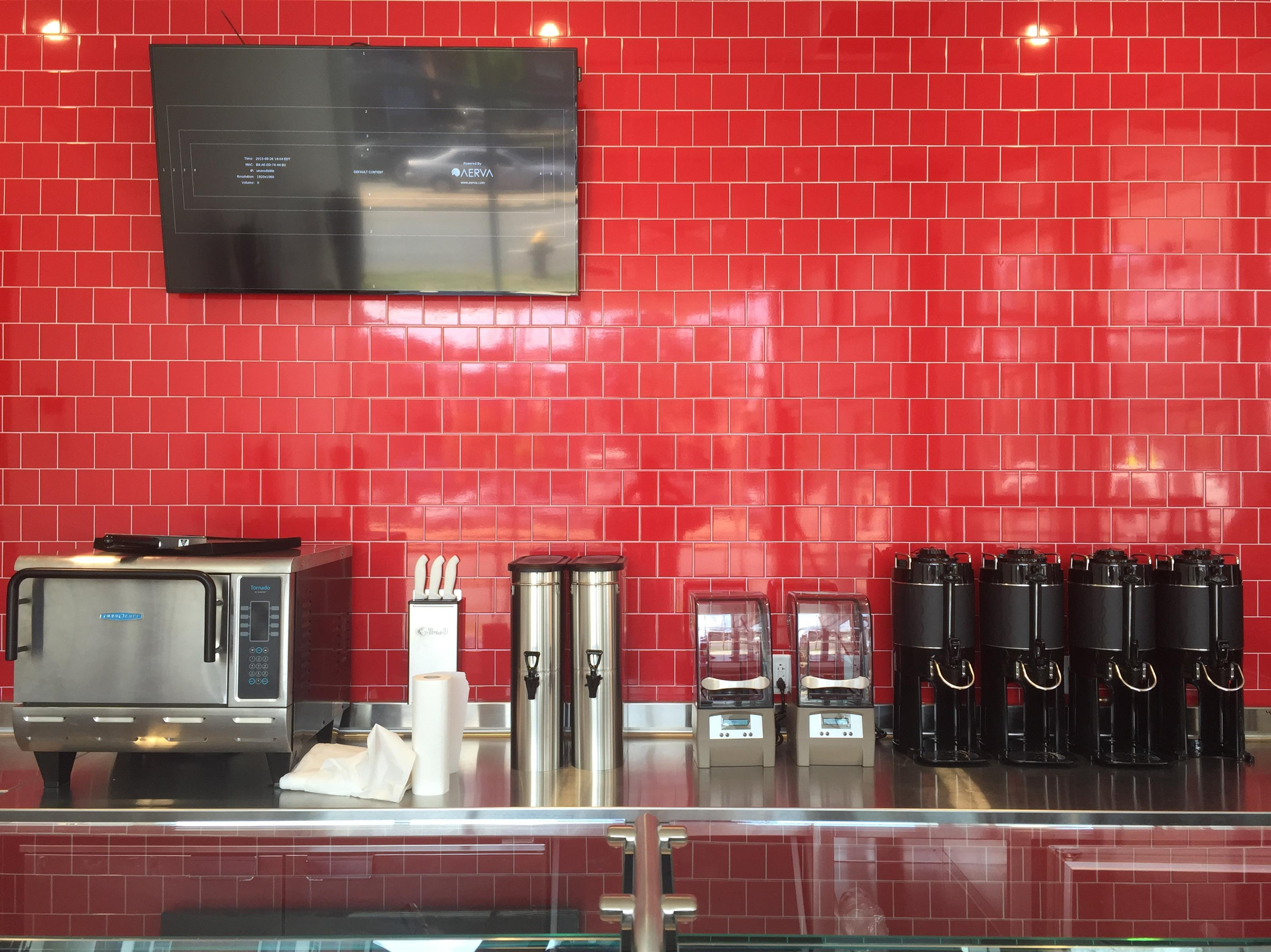 interior design showcasing tiled walling for a cafe area