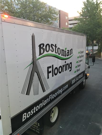 truck with bostonian flooring logo on the side