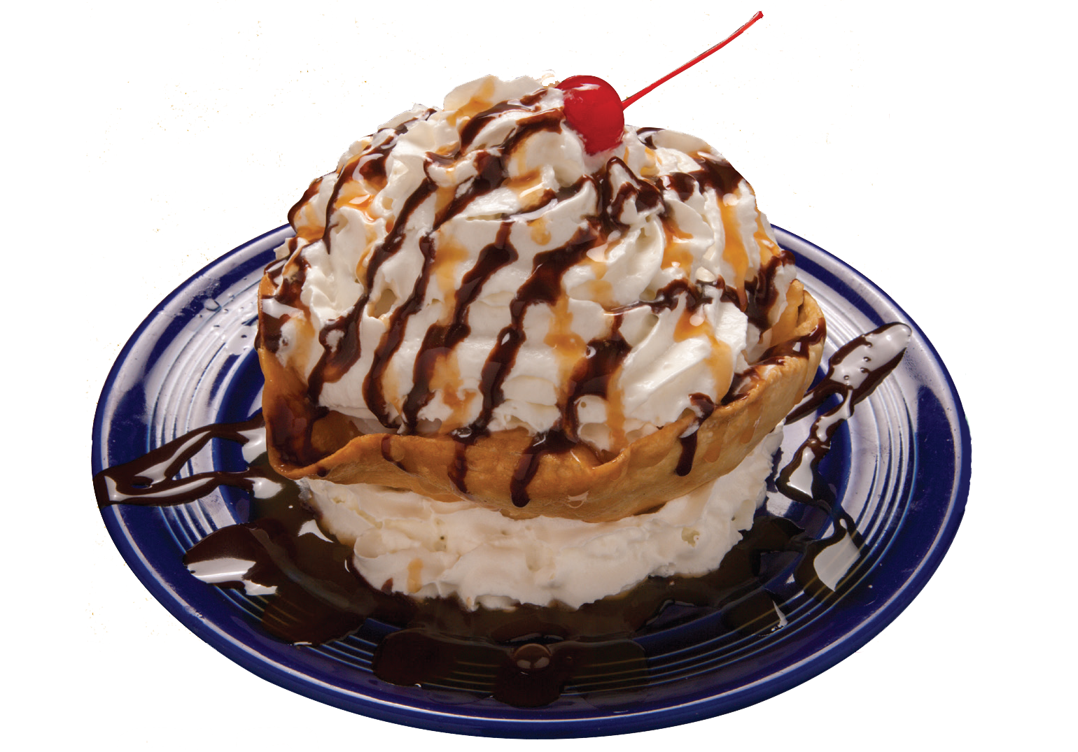 dessert topped with whipped cream, a cherry and chocolate drizzle