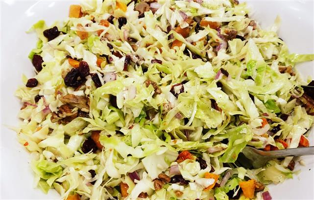A close up view of a salad with a variety of ingredients.