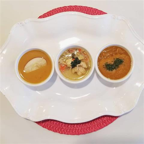A variety of three soups on a serving plate.