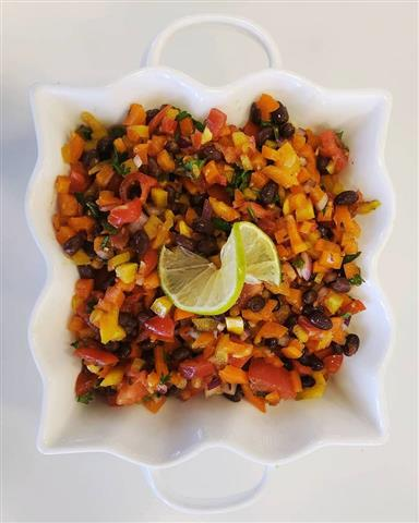 Rice and beans with chopped up tomatoes.