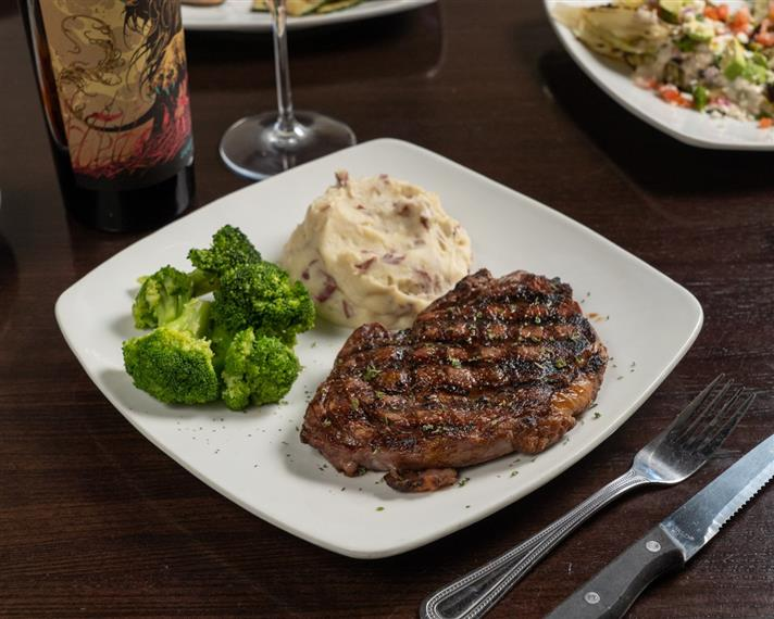 steak with mashed potatoes and steamed broccoli