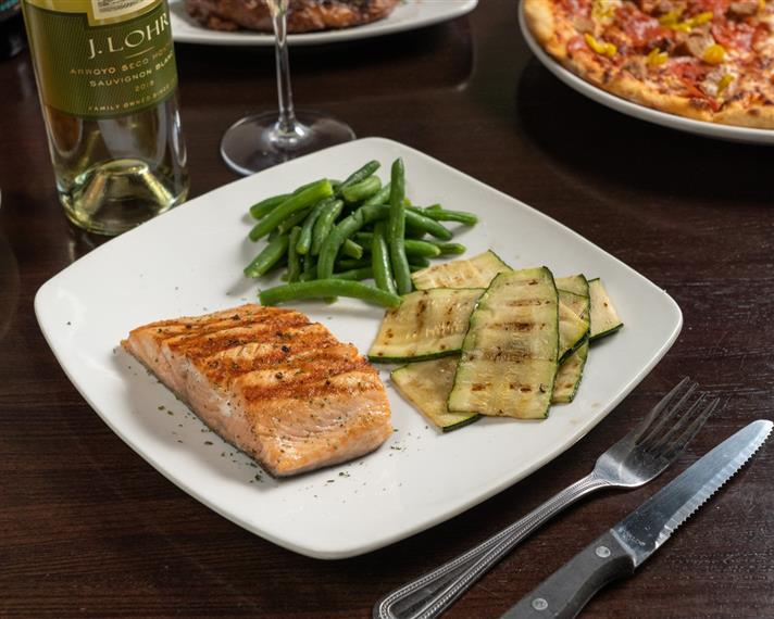 salmon on a plate with zucchini strips and string beans