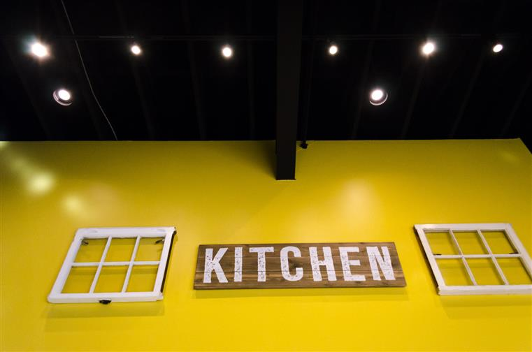 Kitchen sign on interior wall