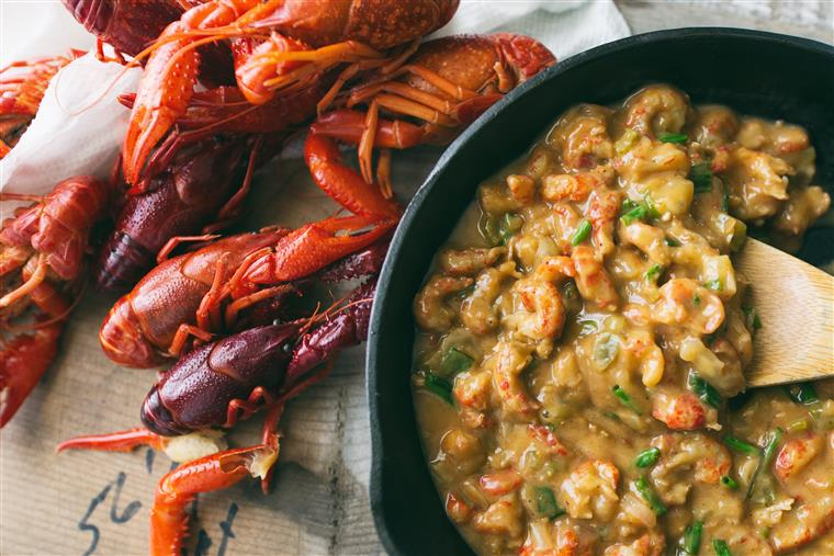 Crawfish next to skillet of crawfish etouffee