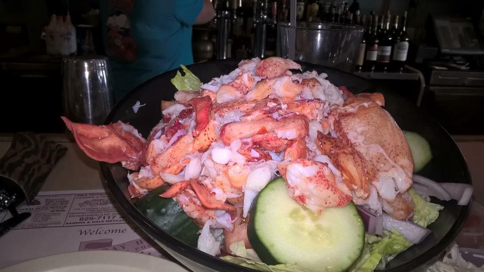 salad with vegetables topped with lobster