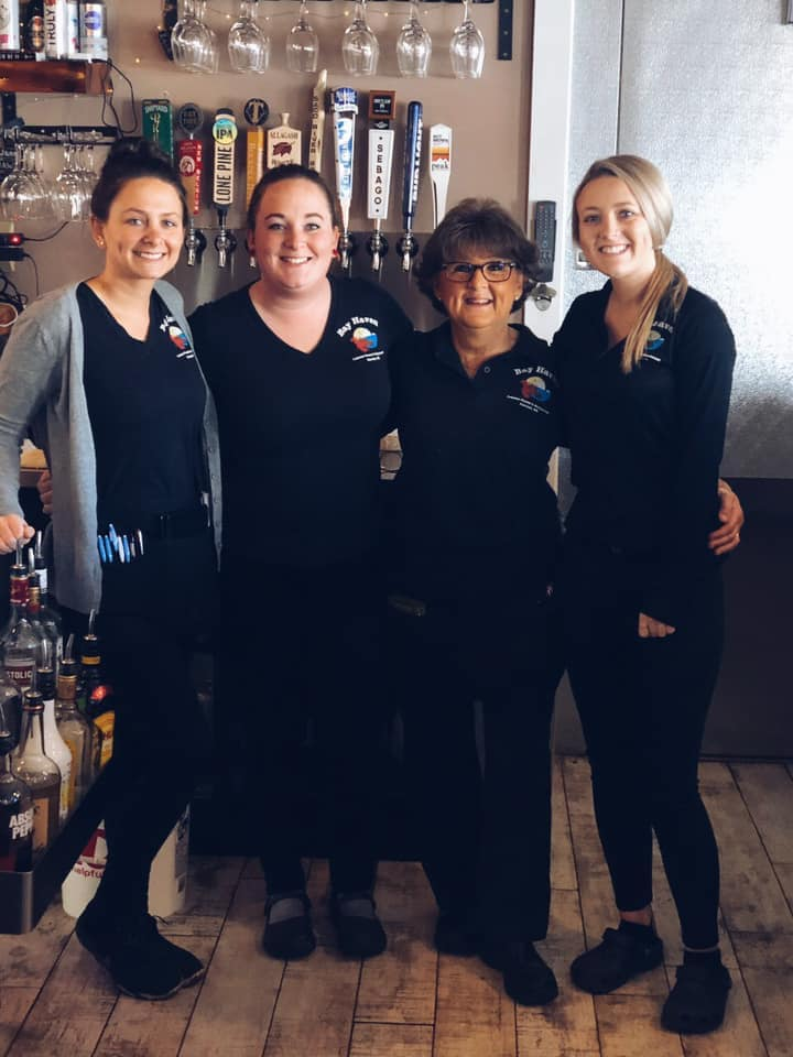 four women employees in the bar area