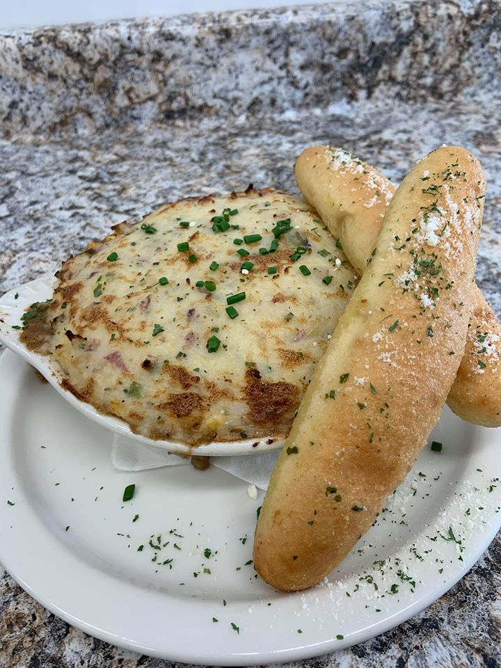 fried cheese dish with bread sticks
