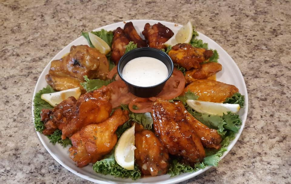 wings on a lettuce spread with bleu cheese