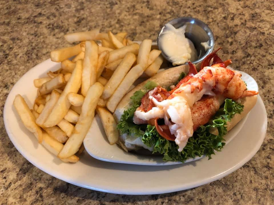 lobster roll with a side of fries
