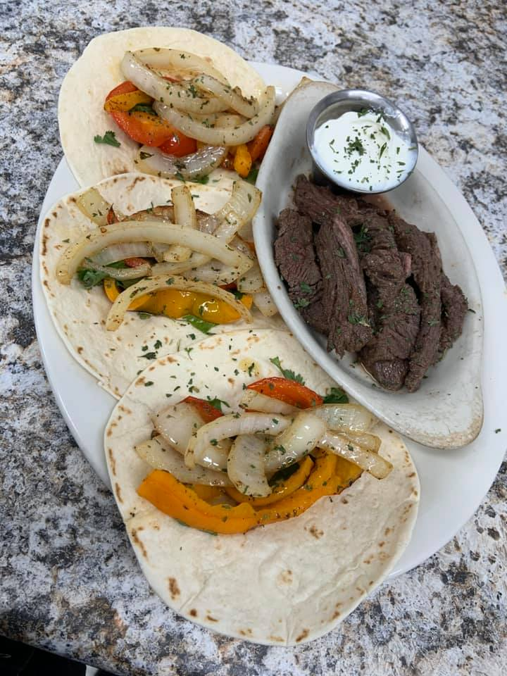 three Steak Fajitas wither peppers and onions