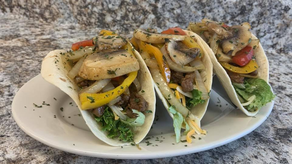 fish tacos with various toppings
