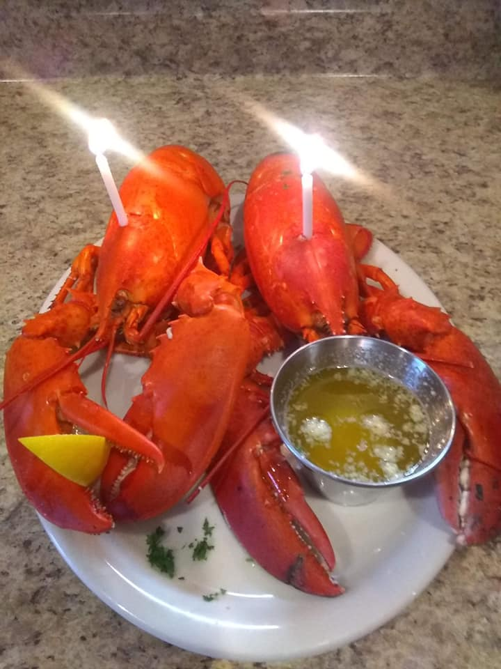 two lobsters with birthday candles in them