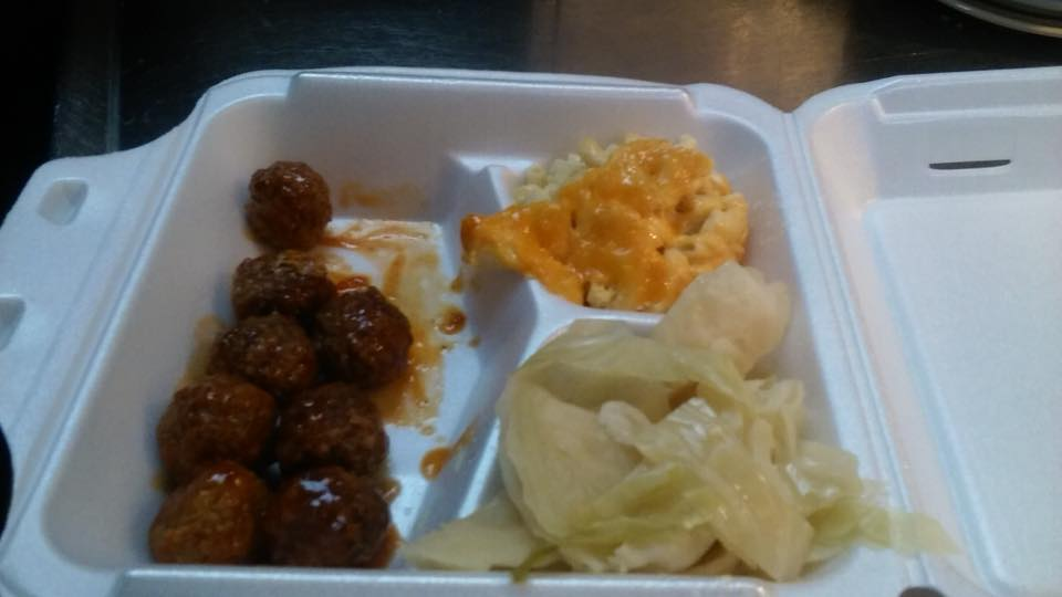 Meatballs served with mac and cheese and salad in a take away container