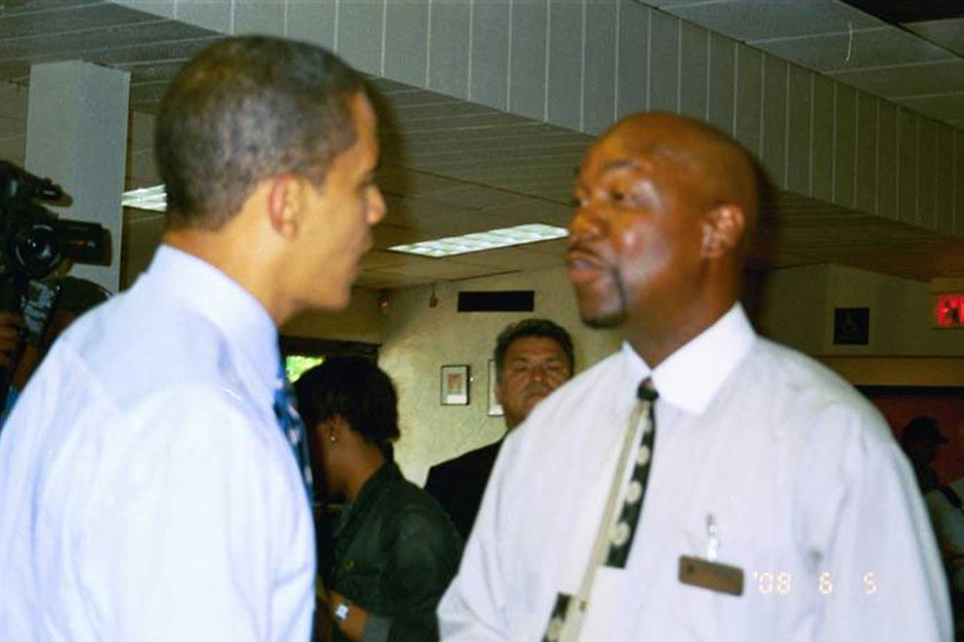 Barack Obama talking to a man