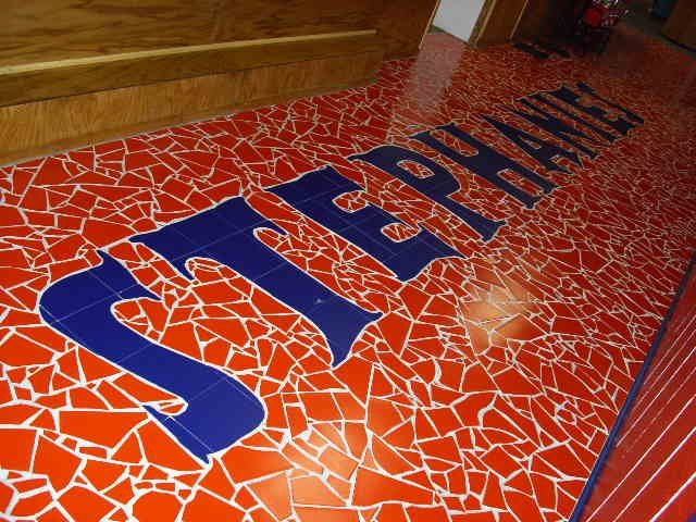 Mosaic of the restaurant logo on the floor