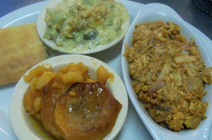 Three side dishes with mac and cheese, sweet potatoes and mashed potatoes