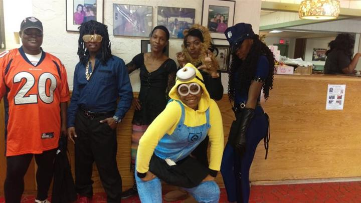 Group of people dressed in costumes posing for a photo