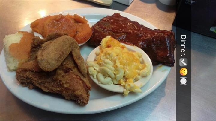 Fried chicken and brisket served with a side of macaroni and cheese and mashed potatoes